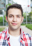 Portait of a smiling student with checked shirt Stock Image