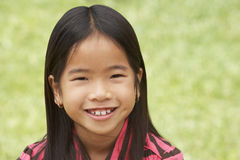 Portait Of Smiling Young Girl Outdoors Stock Photo