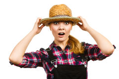 Portait surprised woman wearing hat and dungarees Royalty Free Stock Photos