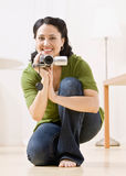 Portait of woman with video camera stock photos