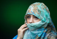 Portait of woman wearing a blue scarf Stock Photos