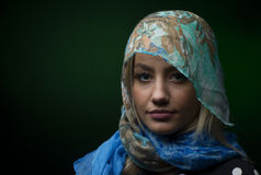 Portait of woman wearing a blue scarf. Isolated Royalty Free Stock Image