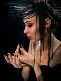 Portait of young beautiful woman like witch Stock Images