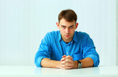 Portait of a young confident businessman sitting at the table Stock Photography
