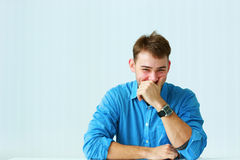 Portait of a young laughing businessman in blue shirt Royalty Free Stock Images