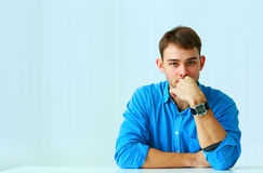 Portait of a young thoughtful businessman in blue shirt Royalty Free Stock Photos