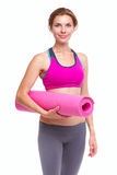Portait of young woman with yoga mat. stock photography