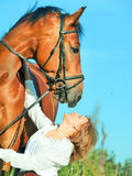Portaits of young girl  with her owner horse Royalty Free Stock Image