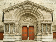 Portal of Arles Cathedral. Stone-carved portal and door of Arles Cathedral, France Stock Images