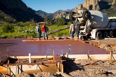 Concrete finished pouring. PORTAL, AZ/USA - APRIL 24, 2019: Workers just completed pouring and leveling the concrete for this foundation royalty free stock images