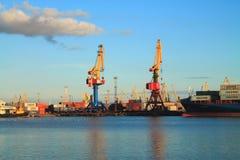 Portal cranes in the Kaliningrad seaport. KALININGRAD, RUSSIA — AUGUST 26, 2014: Portal cranes in the Kaliningrad seaport Stock Images