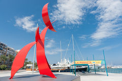 Portal Del Vent, large red sculpture on Denia waterfront, Spain. Stock Photo