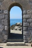 Portal that frames the view to the sea royalty free stock photo