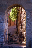 Portal in french village. Looking trough a portal into an alleyway in Roussillon, Provence, France Royalty Free Stock Photography