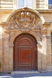 Portal of Hotel de Roquesante (1656). Aix-en-Provence, France. Decorated baroque portal (circa 1656) of Hotel de Roquesante. Aix-en-Provence, France Stock Images