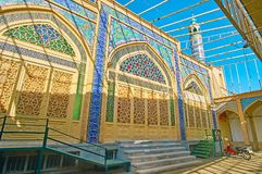 The portal of the Mosque, Kashan, Iran. The scenic mosque`s portal, decorated with ornate tilework, Islamic calligraphy, carved doors and stained glass windows stock photo