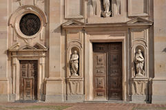 Portal san giovanni church, parma. Detail of monumental portals on facade of renaissance church in parma city center, shot in sunny wheater Stock Photography