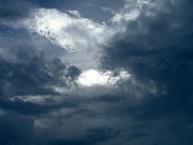 Portal in the Sky. An opening apears in a gloomy sky of clouds stock photo
