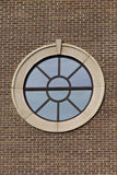 Portal style window on brick wall Stock Images