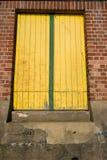 Portal, window or door shut with yellow wood planks Stock Images