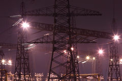 Portals of power lines. Industrial landscape. Night lighting of power lines at dusk in winter Stock Photos