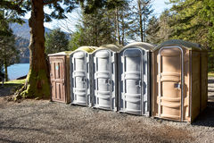 Portapotty in a park yard for public convenience Stock Photography