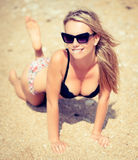 Portarait of young beautiful woman on the seashore sand Royalty Free Stock Photos