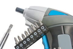Electric accumulator screwdriver with spare tools Royalty Free Stock Images