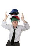 Portare troppi cappelli Fotografia Stock