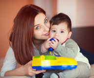 Portarit of pretty mother and her little baby son playing Royalty Free Stock Photos