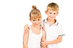 Portarit of smiling boy hugging girl Royalty Free Stock Image