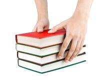 Portata delle mani delle donne per i libri Immagini Stock