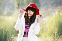 Porte à côté asiatique de fille Photographie stock