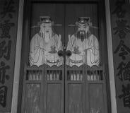 Porte avec des peintures de Dieu dans la ville de Georgre, Penang, Malaisie Images libres de droits