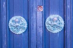 Porte avec le poulpe Image stock