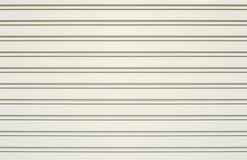Porte blanche de glissière, volet de rouleau Photo stock
