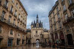 Porte Cailhau Cailhau Gate in the city center of Bordeaux. This medieval gothic gate is one of the symbols of Bordeaux royalty free stock image