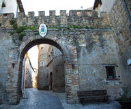 Porte Cochere. Ancient Porte Cochere an arc that served as the entrance to the village Royalty Free Stock Photography