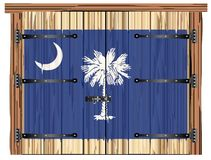 Porte de grange fermée avec Carolina State Flag du sud illustration stock