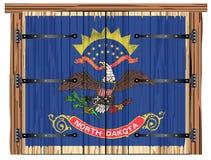Porte de grange fermée avec le drapeau d'état du Dakota du Nord illustration de vecteur