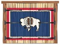 Porte de grange fermée avec le drapeau d'état du Wyoming illustration libre de droits