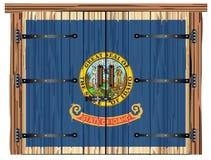 Porte de grange fermée avec le drapeau d'état de l'Idaho illustration stock