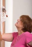 Porte de peinture de femme Images stock