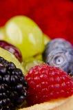 Porte des fruits haut proche de tarte Photos libres de droits