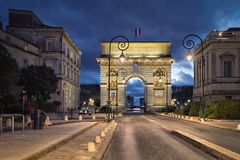 Triumphal arch at dusk in Montpellier, France. The Porte du Peyrou - a triumphal arch in Montpellier at dusk, Occitanie, France royalty free stock photography