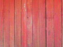Porte en bois rouge antique de mur Image stock