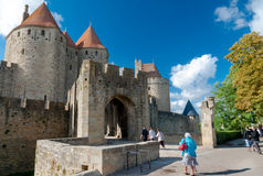 Porte Narbonnaise and turists at Carcassonne Royalty Free Stock Photos
