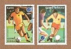 Porte postal de Guine Bissau, selos de correio que mostram jogadores de futebol imagens de stock royalty free