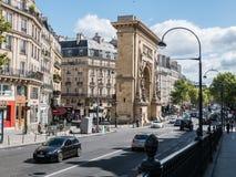 Porte Saint Denis arch, Paris, on a sunny day Stock Photos