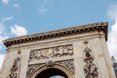 Porte St Denis, Paris, Frankrike triumf- båge Arkivbild